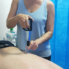 Dr7 Physiotherapist Katie using the cupping technique.